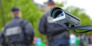 a surveillance camera and 2 policemen