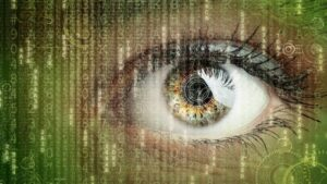 human eye overlayed by vertical streams of code