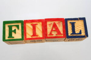 """Wooden blocks spelling out """"FIAL"""""""