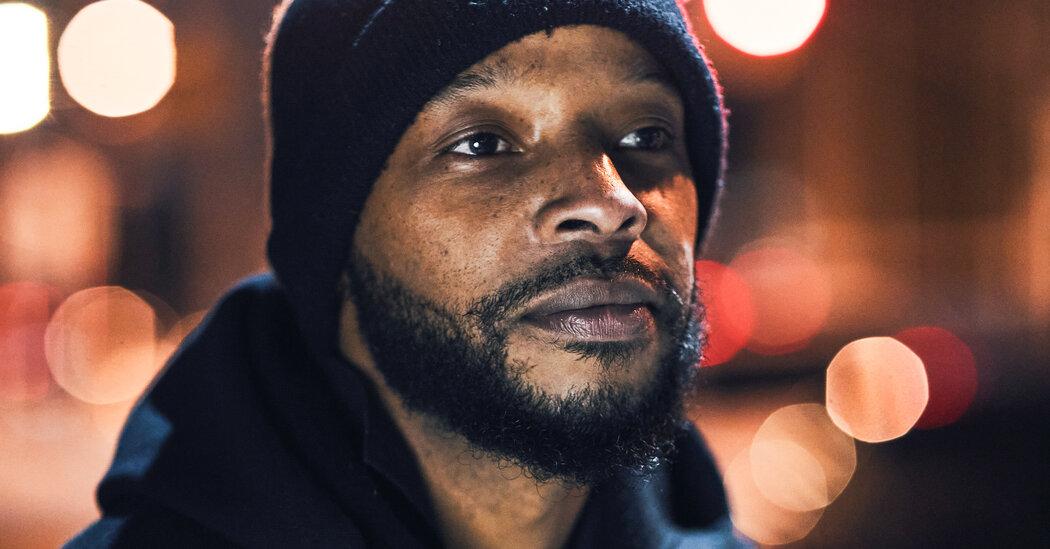 A black man in a hat